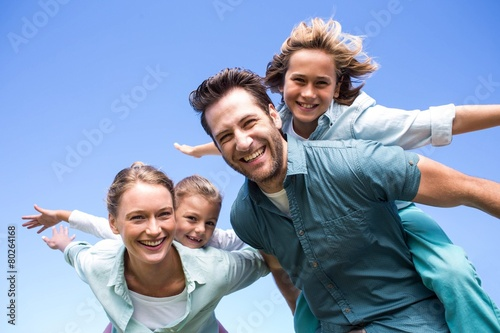Happy parents with their children - 80264168