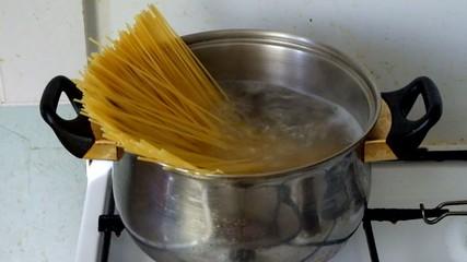 Stirring spaghetti in a boiling water
