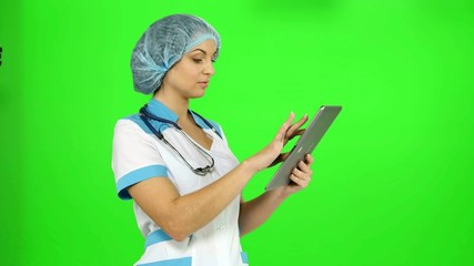 Doctor with stethoscope and a tablet in hands nnabiraet