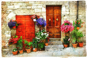beautiful floral streets of old italian village. Spello, artisti