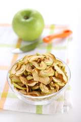 Dried apple slices and fresh apple