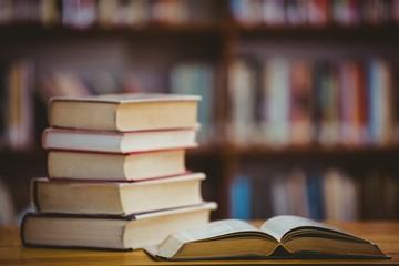 Books on desk in library
