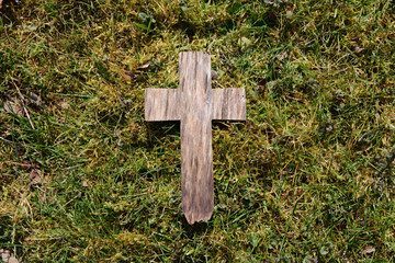Easter wooden cross on grass
