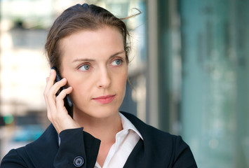 Beautiful business woman listening to phone call on mobile