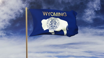 wyoming flag with title waving in the wind. Looping sun rises