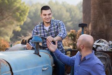mechanics reparing old agrimotors at farm