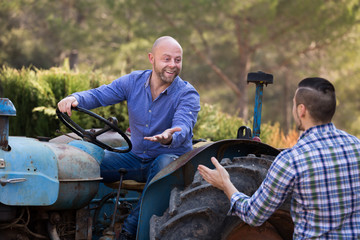 Farmers near agricultural machinery
