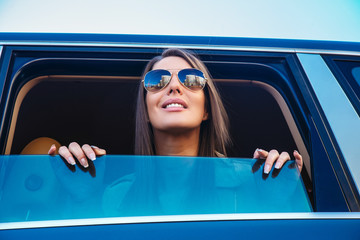 Awesome woman in sunglasses smiling