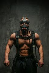 Muscular firefighter in oxygen mask