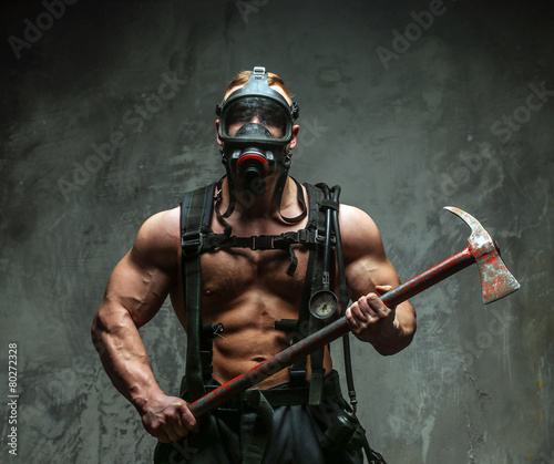 Muscular firefighter with axe - 80272328