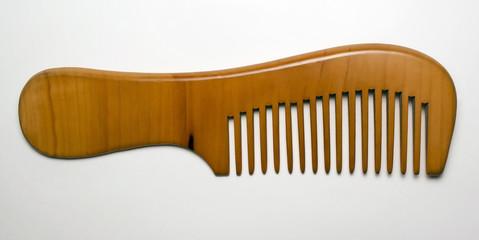 Elegant wooden comb on white background