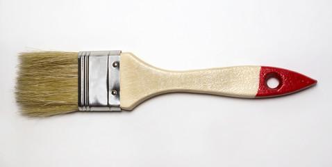 Wooden brush for finishing works on white background