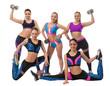 Team of pretty sportswomen posing in studio