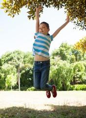 Cute little girl jumping up
