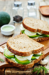 sandwiches with avocado, cheese, cabbage and cheese and herb top