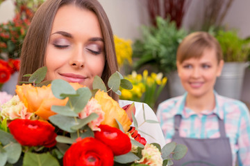 Customer smells the bouquet