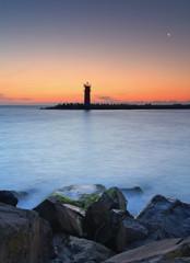 Seascape at sunset - lighthouse on the coast