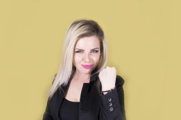 Young attractive woman saying stop (hand, fist, yellow)
