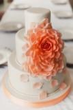 Wedding white cake with mastic and cream orange flower poster