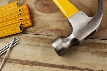 Hammer, nails and folding ruler