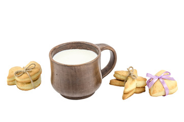 Set of cookies and cap of milk isolated on white