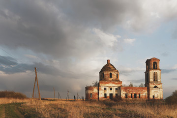 Destroyed Orthodox Church in the field. Evening.