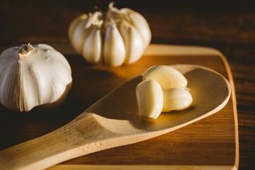Garlic cloves and bulb on chopping board