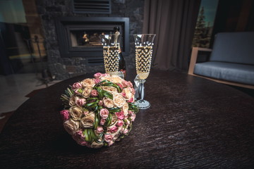 Bride bouquet with glass of champagne