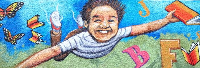 Boy with book-graffiti