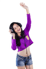 Attractive teenage girl enjoy music