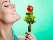Portrait of smiling woman holding healthy food. - 80278344