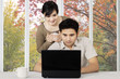 Couple with laptop on table