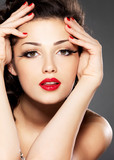 Beauty fashion woman with red nails and makeup
