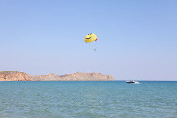 parachute over the sea