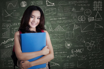 Female college student smiling in the class