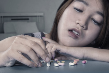 Girl using narcotic shaped pills