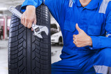 Male mechanic showing thumb up in workshop - 80279566