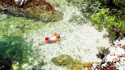 Little boy snuckering in the warm Adriatic sea waves