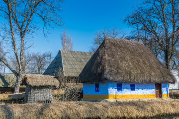 Authentic Romanian village house covered with straws