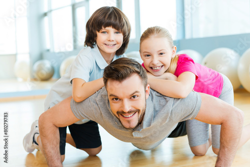 Exercising with father. - 80279783