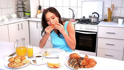 Woman breakfast at kitchen.