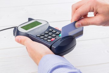 Man swiping his credit card