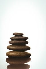 Zen stones balancing on white background