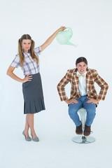 Geeky hipster watering her boyfriend
