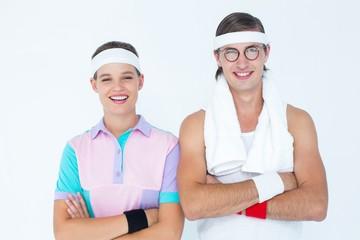 Geeky hipster couple posing in sportswear
