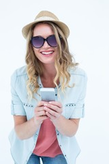 Smiling woman texting with her smartphone