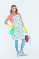 Woman wearing protective gloves and holding bucket