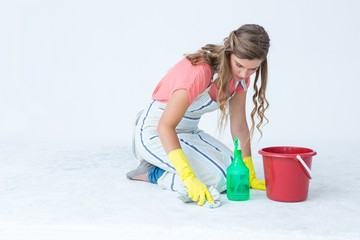 Hipster woman cleaning the ground