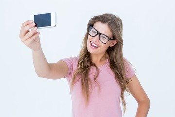 Pretty blonde taking a selfie of herself