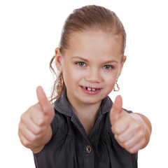 Little girl dressed in blue is showing thumb up gesture using bo